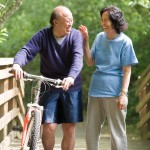 Senior couple talking and exercising at a park